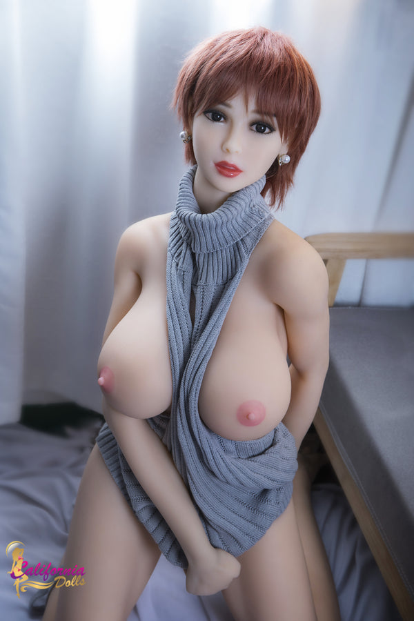 Gorgeous sex doll exposes huge pointed boobs.