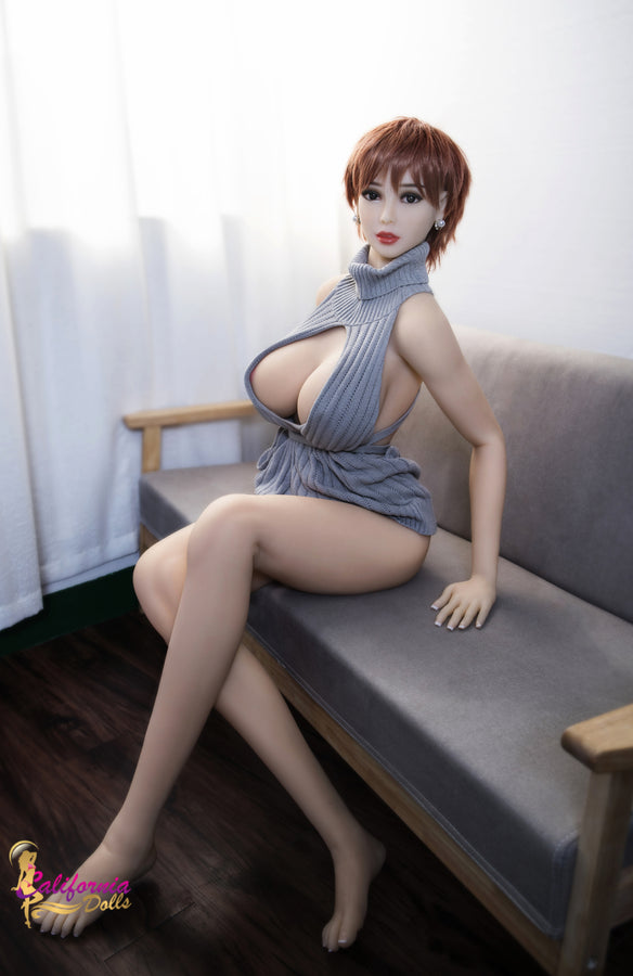 Long beautiful slender legs on sex doll.
