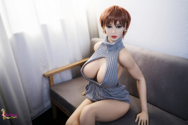 Big breast sex doll sits on couch.