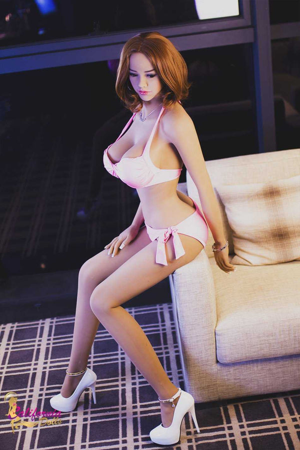 Tall sex doll with shoulder length brunette hair.