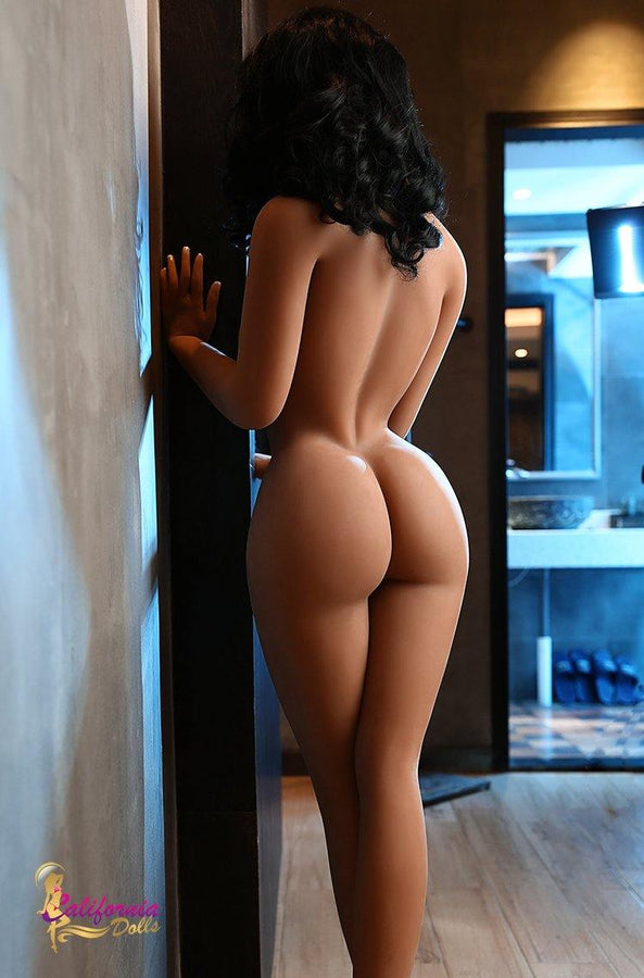Nude sex doll shows big round ass.