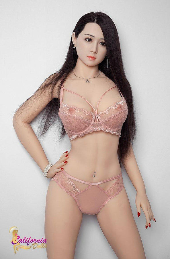 Large breast sex doll wearing sexy pink bikini.