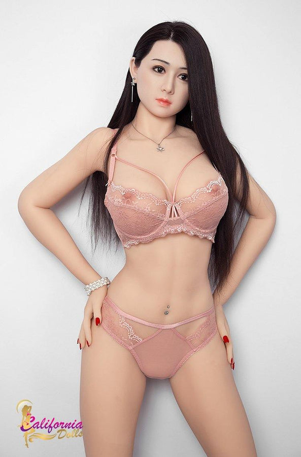 Realistic sex doll with hand on crotch.
