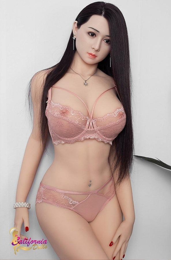 Beautiful Japanese sex doll with hand on hip.