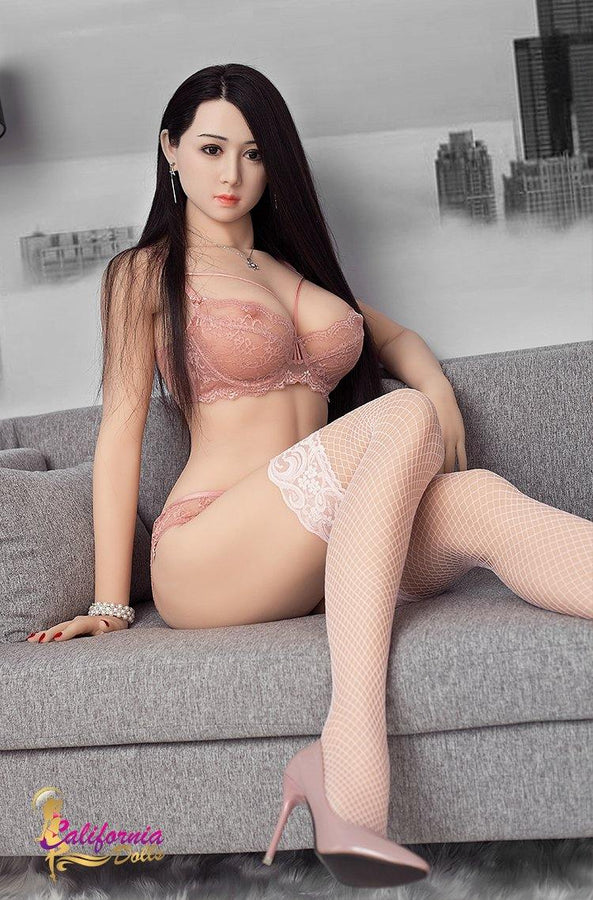 lifelike Japanese sex doll sits on sofa