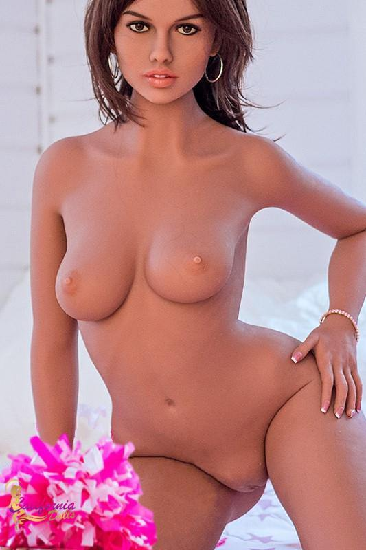 Nude sex doll revels tan tits and shaved vagina.