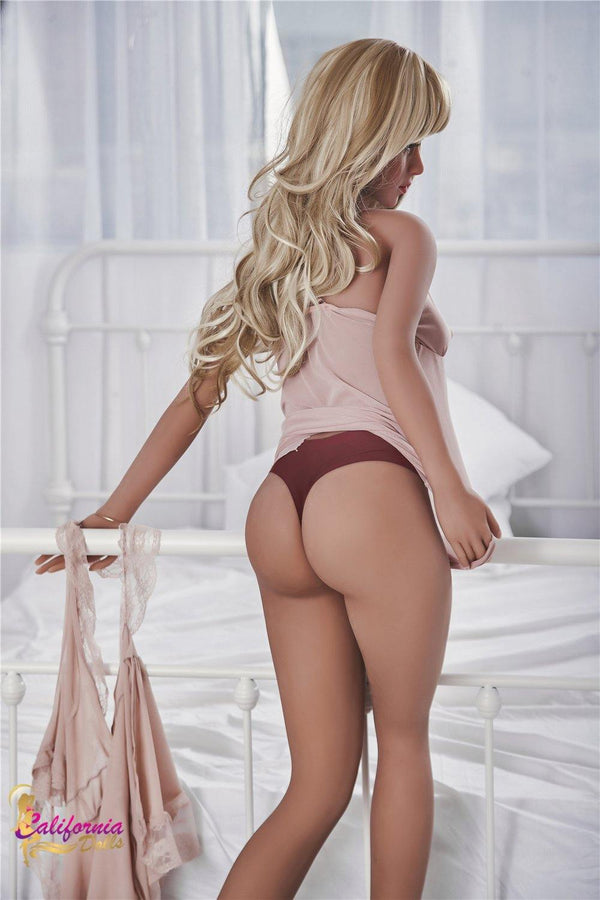 Pretty sex doll in a red thong.