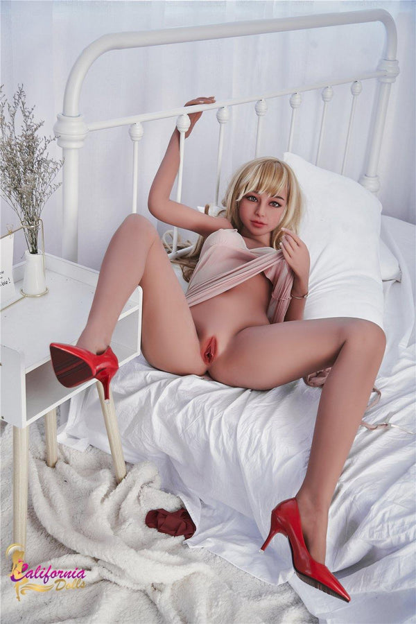 Sex doll holds top up revealing her desirable pussy.