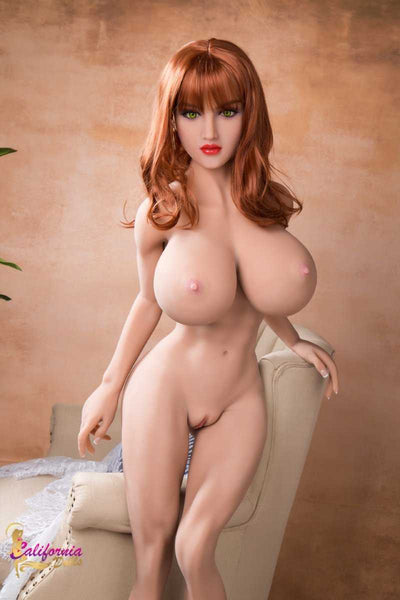 Large breast sex doll stands naked showing vagina.