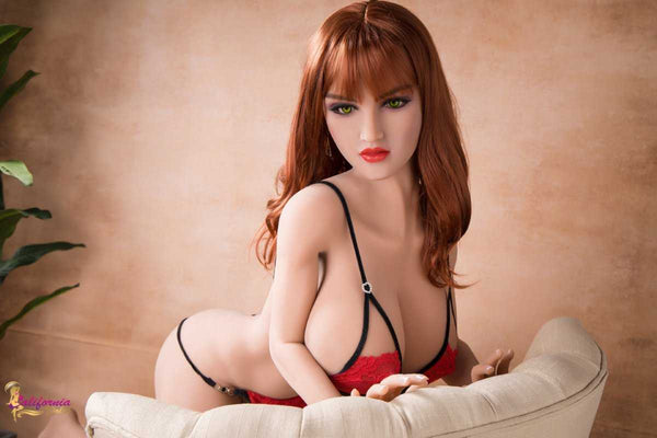 Pretty face outlined by wavy redhead sex doll.