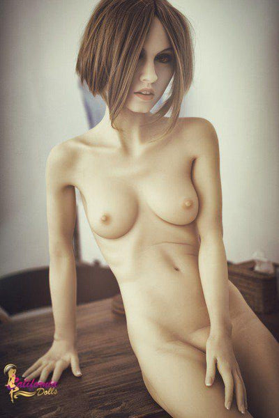Nude sex doll with her small exposed breast and vagina.