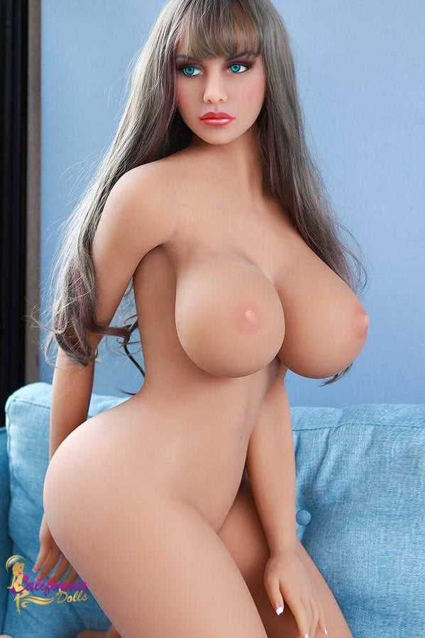 Lifelike sex doll standing nude.