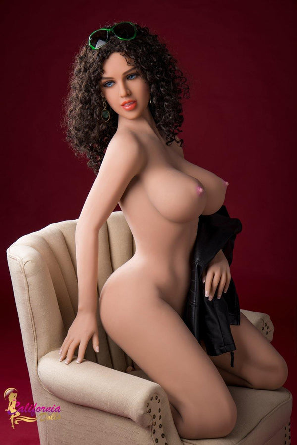 Robotic sex doll with large pointed breast.