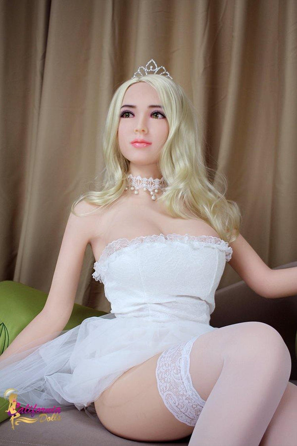 Robotic sex doll with golden blonde hair.