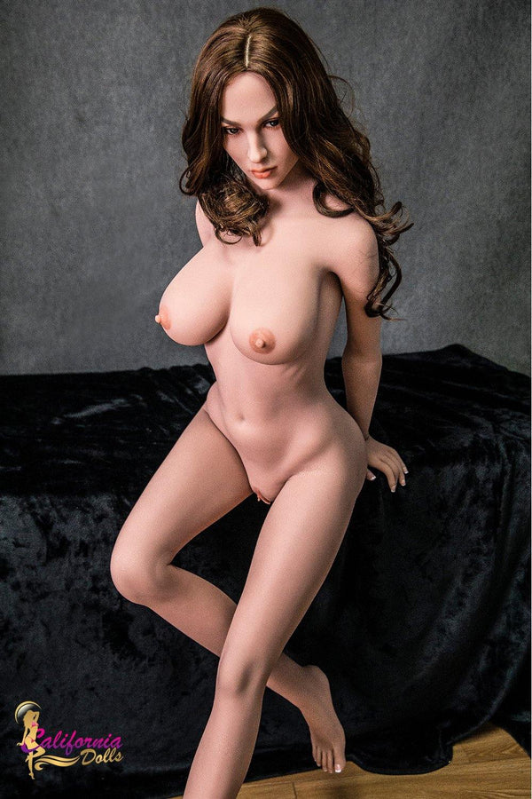 All Dolls Naked big breasts love doll Mia Leans against the edge of the table