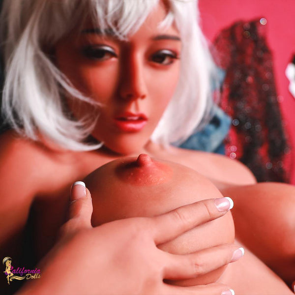 Silicone sex doll with big firm breast and perky nipples.