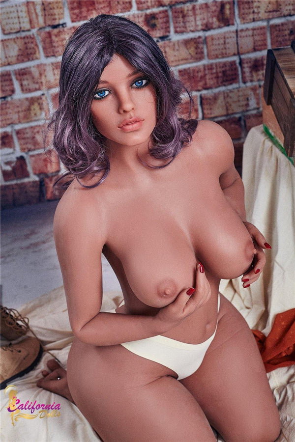 Topless Yvette shows her big, firm, tan breast