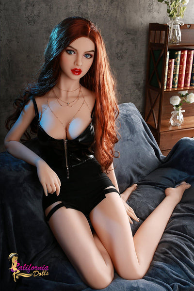 long red head doll sits on the sofa