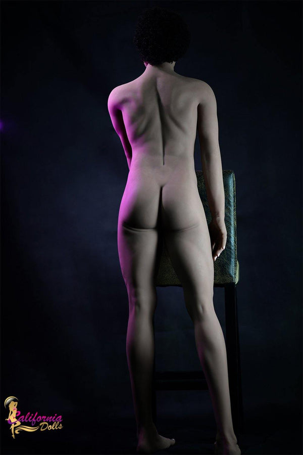 Backside photo of nude male standing