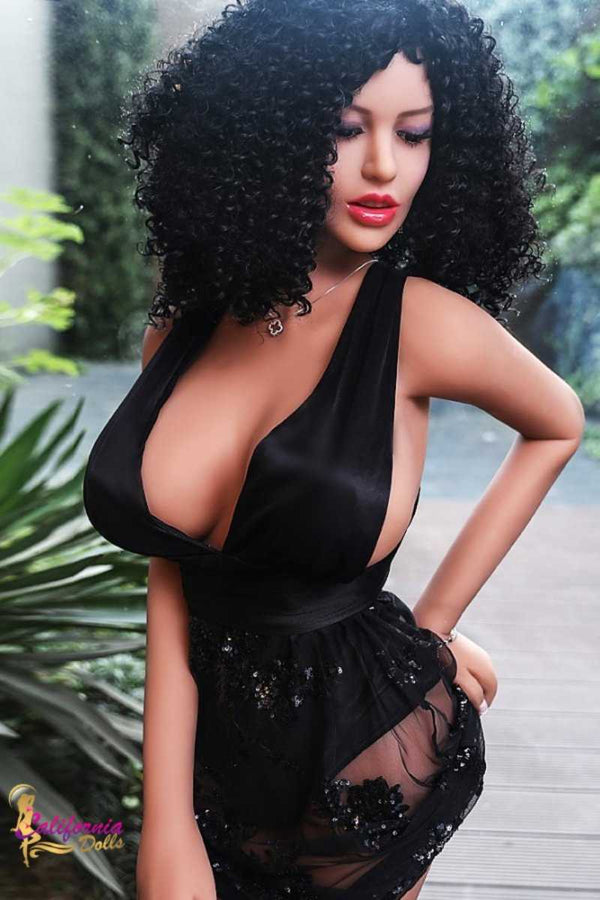 Skinny top barely covers nipples of black sex doll.