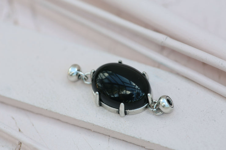 BLACK AGATE PRONG SET OVAL 12X18MM SILVER