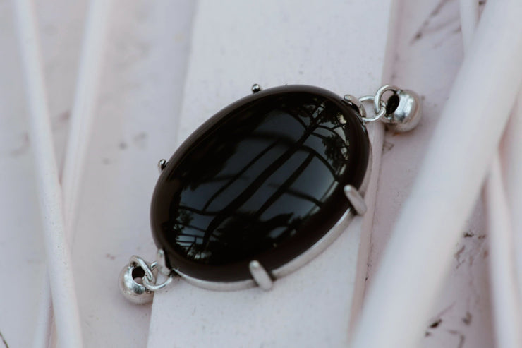 BLACK AGATE PRONG SET OVAL 18X25MM SILVER