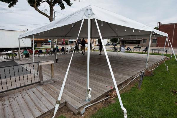 frame tent set up for outdoor bar