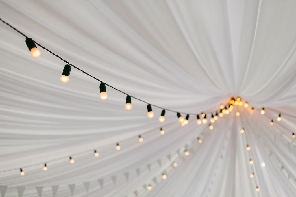 How to Decorate a Tent for a Graduation Party with Lights