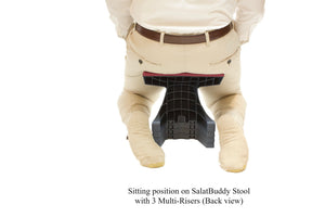 Sitting in kneeling position (back view) while using SalatBuddy Contemporary Prayer and Poster Stool with 3 Multi-Risers