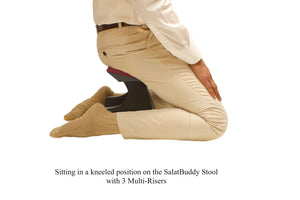 Sitting in kneeling position while using SalatBuddy Contemporary Prayer and Poster Stool with 3 Multi-Risers