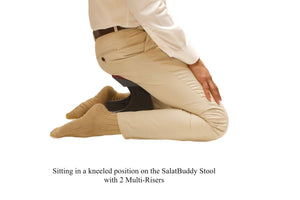 Sitting in kneeling position while using SalatBuddy Contemporary Prayer and Poster Stool with 2 Multi-Risers