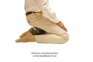 Sitting in kneeling position while using SalatBuddy Contemporary Prayer and Poster Stool