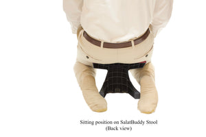 Sitting in kneeling position (back view) while using SalatBuddy Contemporary Prayer and Poster Stool
