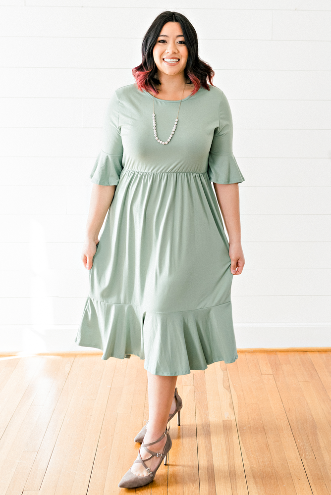 The Maggie Millan- Sage Colored Bell Sleeve Midi Dress