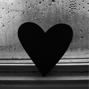 black heart in rain