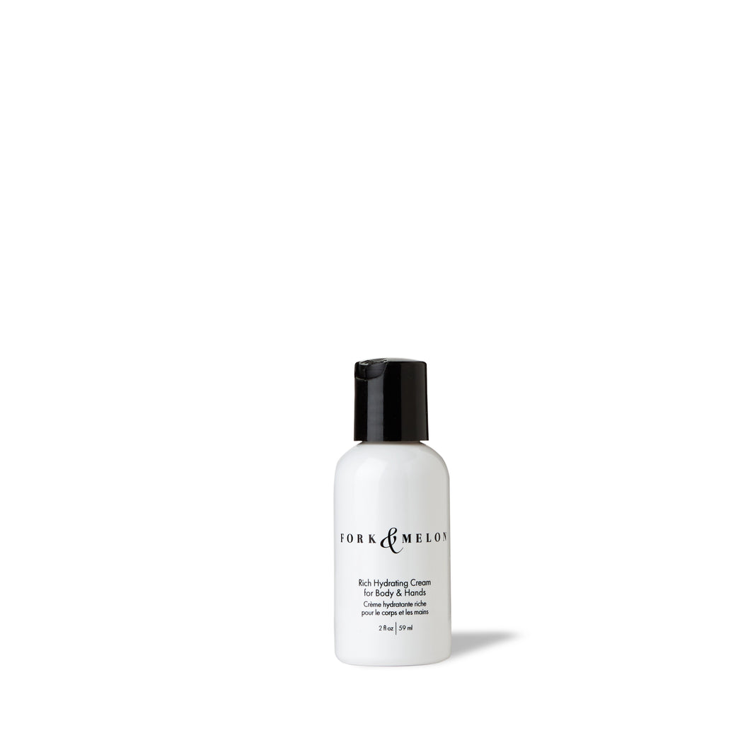 Travel-size black and white hand lotion / body lotion by FORK & MELON