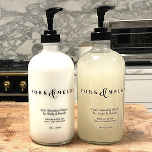 glass soap & lotion set in marble kitchen