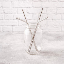 Load image into Gallery viewer, silver reusable straws in glass