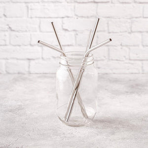 silver reusable straws in glass