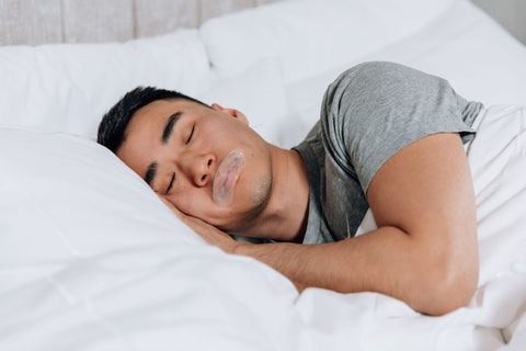 Man sleeping with mouth tape