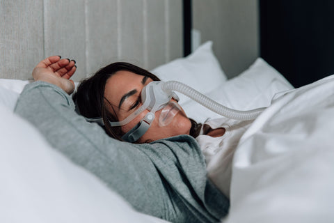 woman sleeping with CPAP mask