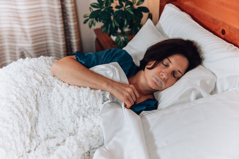 woman sleeping with mouth tape on