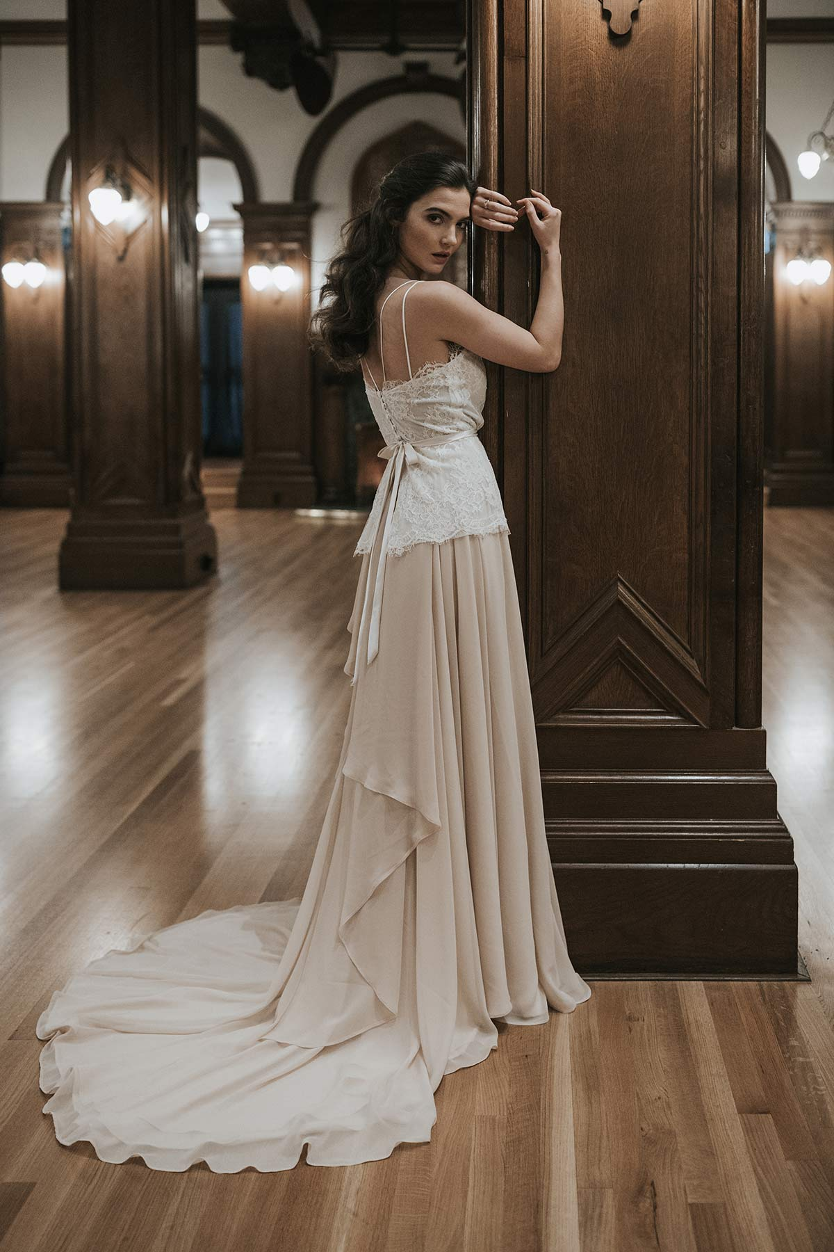 Lavictoire editorial Thetis wedding dress side lace and straps top and long train light nude skirt