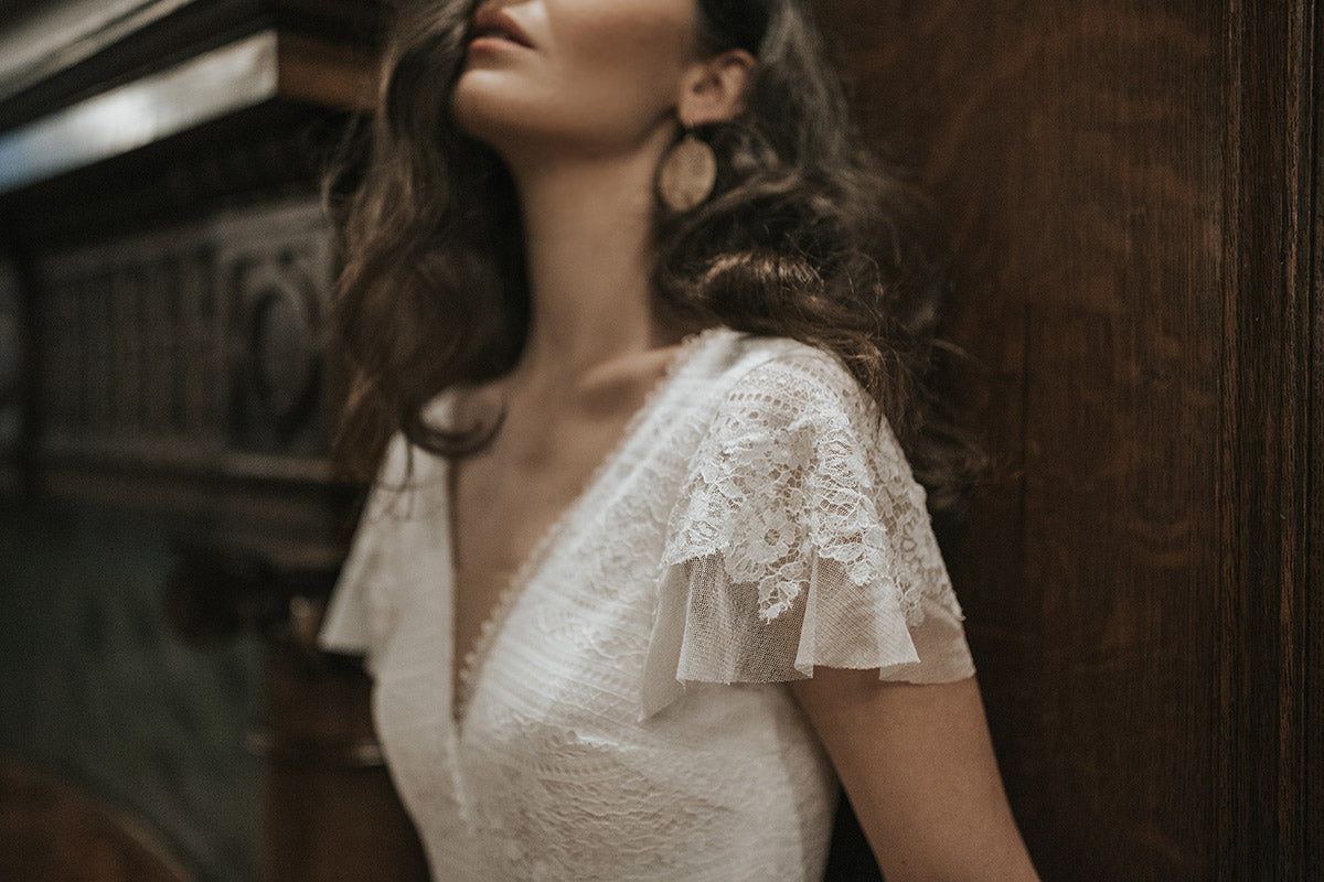 Lavictoire editorial Union wedding dress V neckline flutter sleeve front side lace upper body