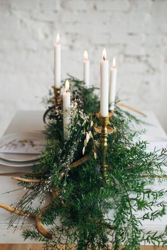 Tablescape with gold candlesticks and ferns