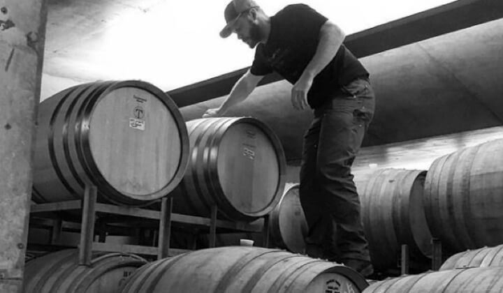 Dredgey amongst his Pinot barrels