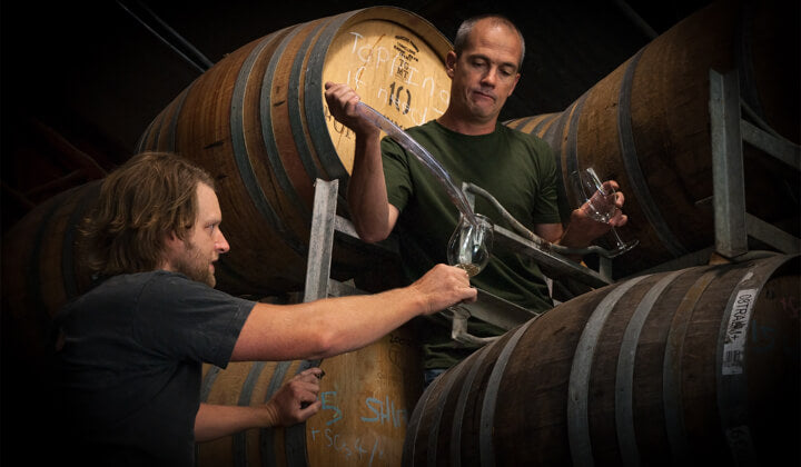Craig and Anthony thieving wine from barrel