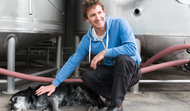 Luke and his pup in the winery