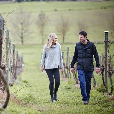 Sam and sister Claire in the vineyard