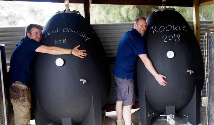 Uffe and Jens loving their concrete egg fermenters